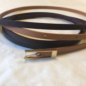 Three faux leather belts